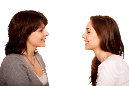Mother and teenage daughter talking and laughing together
