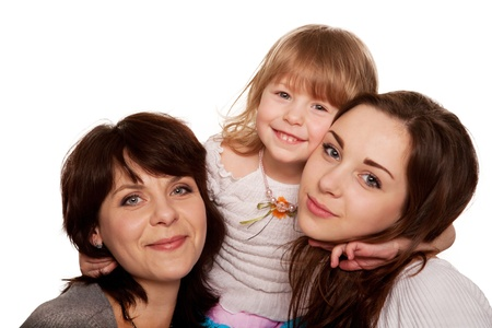 Happy mother and two daughters, a teenager and a toddler  Isolated on white background