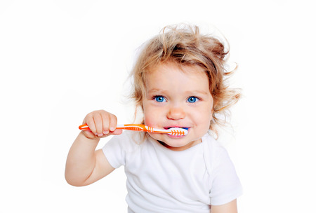 Photo for Curly baby toddler brushing teeth. Isolated on white background. - Royalty Free Image