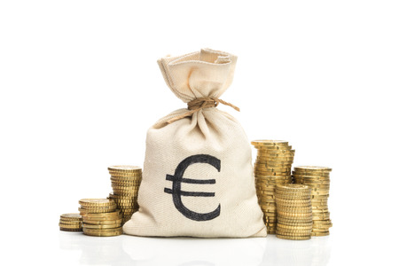 Money bag and Euro coins, isolated on white background