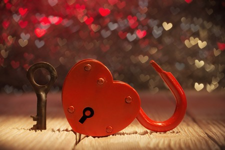 Photo pour Unlocked heartshaped padlock over abstract Valentines day background - image libre de droit