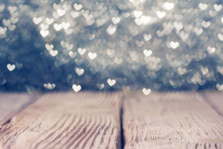 Photo pour Vintage wooden  deck over heart shaped defocused lights. Shallow DOF - image libre de droit
