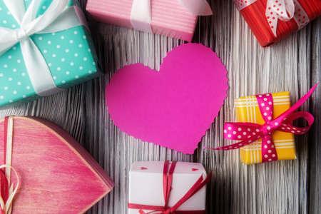 Photo pour Heart shaped pink card and various gift boxes. Valentine's day concept - image libre de droit