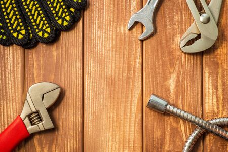 Photo pour Necessary set of tools for plumbers on a vintage wooden wooden background. Also space for advertising. - image libre de droit
