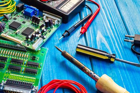 Photo pour Services for the production of electronics and repair on a wooden blue - image libre de droit
