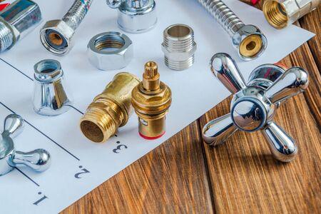 Photo pour Spare parts and accessories for plumbing repair on a note sheet - image libre de droit