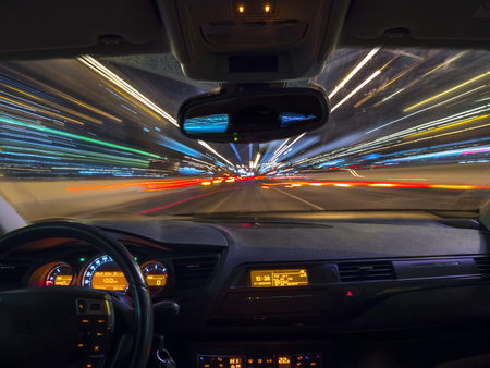 Photo pour Car driving fast speed at night, view from inside a car - image libre de droit