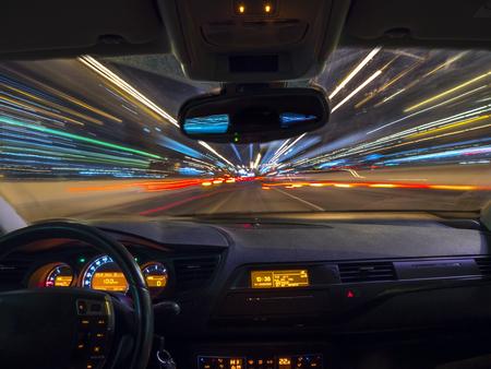 Foto de Car driving fast speed at night, view from inside a car - Imagen libre de derechos