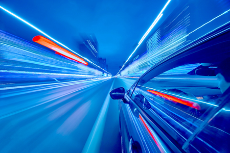 Photo for View from Side of Car moving in a night city, Blured road with lights with car on high speed. Concept rapid rhythm of a modern city. - Royalty Free Image