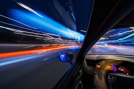 Photo for View from interrior of a Car moving in a night city, Blured road with lights with car on high speed. Concept rapid rhythm of a modern city. - Royalty Free Image