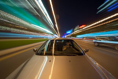 Photo for View from Front of Car moving in a night city, Blured road with lights with car on high speed. - Royalty Free Image