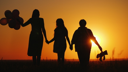 Photo pour Mother daughter and grandmother together admire the sunset. Active seniors concept - image libre de droit