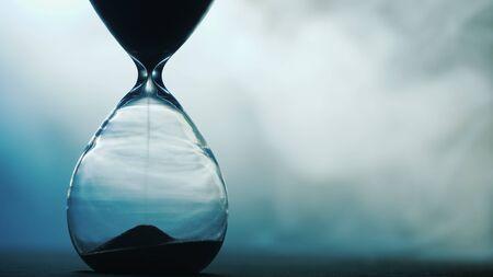 Photo pour Detail of old hourglass, grains of sand fall down measuring time - image libre de droit