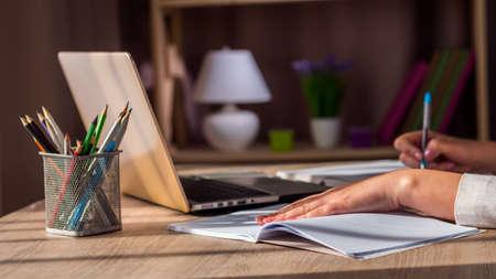 Photo pour Woman works near laptop at home, working in quarantine - image libre de droit