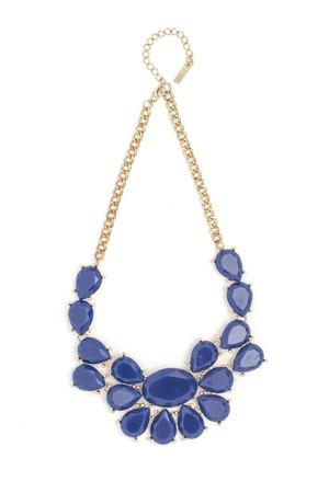 Photo pour Gold necklace with blue stones isolated on white - image libre de droit