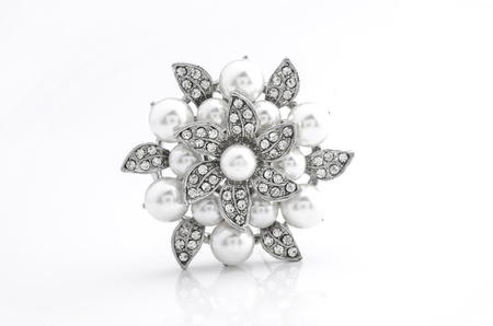 silver brooch flower with pearl on isolated on white
