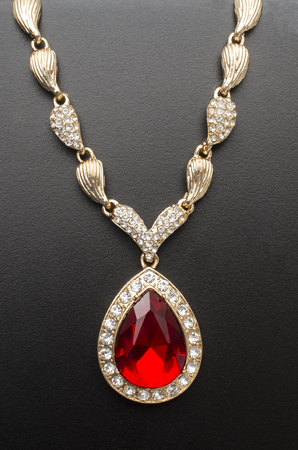 Photo pour golden pendant with ruby and diamonds isolated on black - image libre de droit