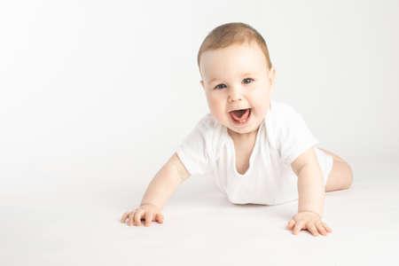 Photo pour portrait of a smiling baby lying on his stomach - image libre de droit