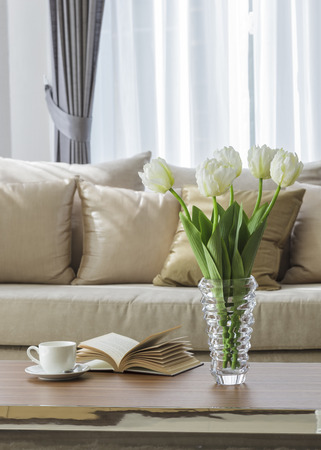 Living room sofa with flower coffee and book on table