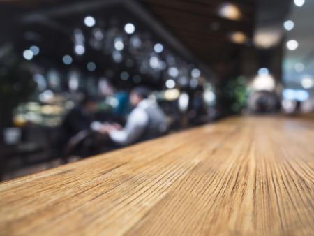 Photo pour Table top counter Bar restaurant background with people - image libre de droit