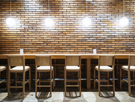 Photo pour Table counter Bar with Chairs and Lights Brick wall background Hipster Loft Interior - image libre de droit