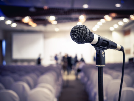 Foto de Microphone in Conference Seminar room Business Meeting Event Background - Imagen libre de derechos