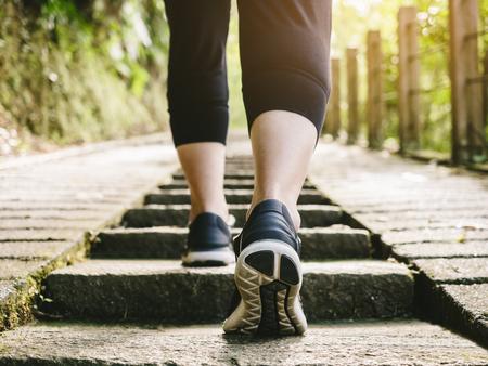 Photo pour Woman walk step exercise outdoor sport shoe Trail Track - image libre de droit