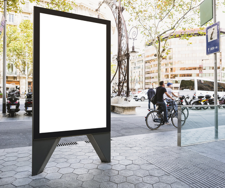 Foto de Mock up Banner stand Media outdoor Information Sign with people riding on City street - Imagen libre de derechos