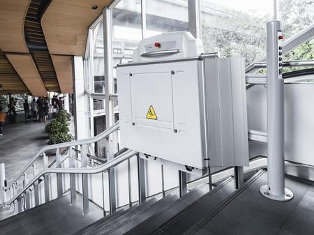 Photo pour Disability stairs lift facility indoor building Wheelchair elevator - image libre de droit