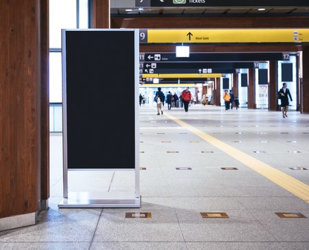 Photo pour Mock up Board Sign stand in Train station with People walking - image libre de droit