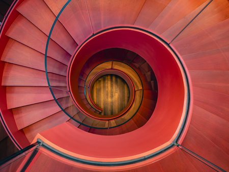 Foto de Spiral staircase Modern Architecture detail Red colour Abstract Background - Imagen libre de derechos