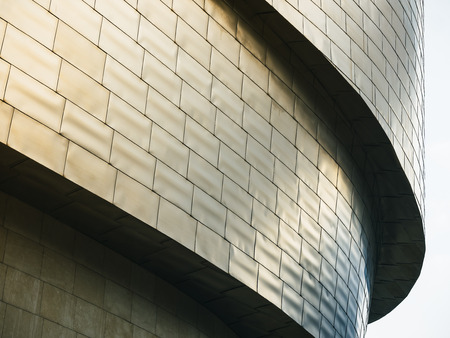 Photo for Architecture details Modern building Futuristic Metal wall tiles facade Curve and space - Royalty Free Image