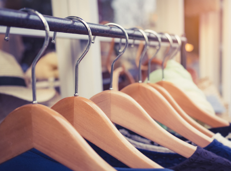 Photo pour Clothing on Hangers Fashion retail Display Shop Business concept - image libre de droit