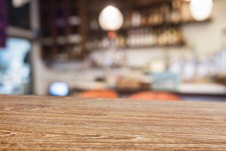 Photo pour Table top Wooden counter Bar cafe blur background - image libre de droit