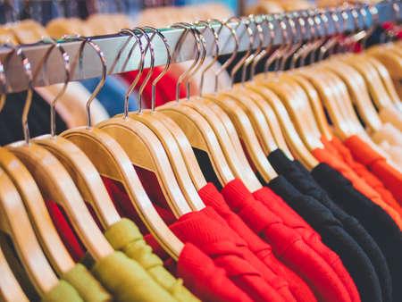 Photo pour Clothing on Hangers Fashion retail Display Shop Colourful T shirt Business concept - image libre de droit