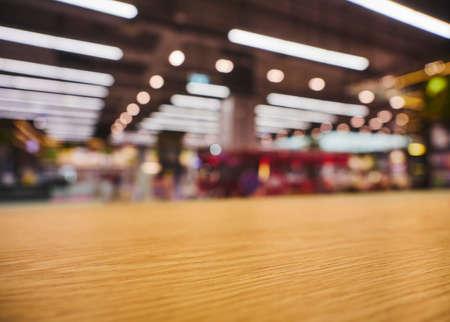 Photo pour Table top counter with neon lighting Retail shop interior blur background - image libre de droit