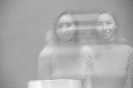 Photo pour Close up emotional portrait of happy blonde woman. Monochrome, black and white. Motion blur and double exposure - image libre de droit