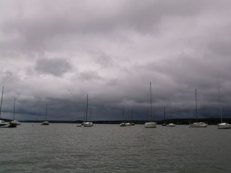 A lot of yachts under dark cloudy sky