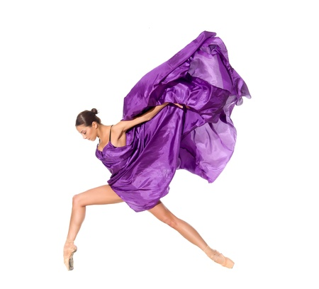ballet dancer in the flying jump into the tissues isolated on white background