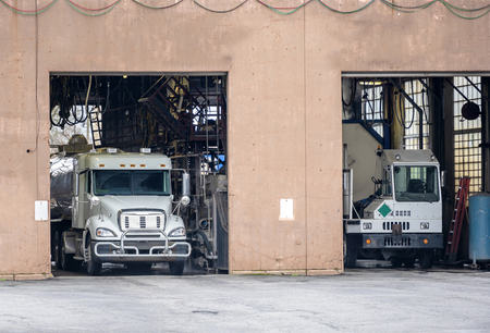 Automatic washing for large semi trucks with trailers located in a specially equipped industrial building to ensure the sanitary - technical norms of the movement of commercial vehicles on the roads