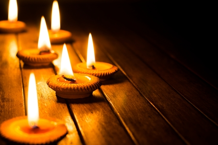 Photo for candle light on wood plate - Royalty Free Image