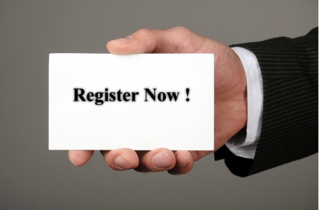 businessman showing his business card with the message register now