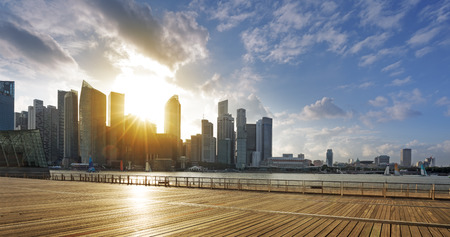 Central business district of Singapore and promenade at sunset