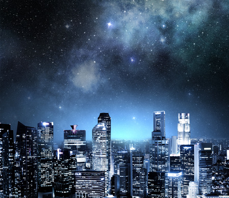 city skyline at night under a starry sky