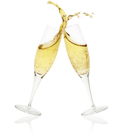Photo for two champagne glasses toasting on white background - Royalty Free Image