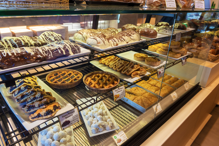 NAXOS, GREECE - May 24, 2017: Different types of traditional Greek cakes in pastry shop.