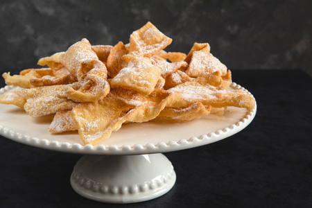 Photo for Faworki, Chrusty, Angel Wings - traditional Polish pastries served during Carnival. Fat Thursday, just befor Lent. - Royalty Free Image