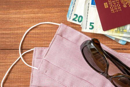 Photo pour Virus protective mask and international Polish passport. Travel concept, tourism care, corona virus disease. - image libre de droit