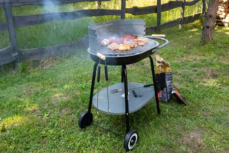 Photo pour Grilling sausages and meat on barbecue grill. Barbeque grill fireplace. - image libre de droit