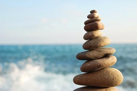 Stone tower on a pebble beach